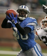 Lions receiver Charles Rogers makes the touchdown grab against Browns defensive back Chris Crocker during second quarter action on Aug. 20, 2005, at Ford Field.