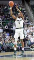 Cassius Winston hits his first shot of the game against Binghamton on Sunday.