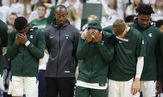 The Breslin Center observes a moment of silence for Zachary Winston, the brother of Michigan State Spartans guard Cassius Winston, center, before action against the Binghamton Bearcats, Sunday, Nov. 10, 2019 in East Lansing.