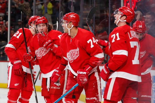 Detroit Red Wings defenseman Madison Bowey (74) is congratulated after scoring during the third period against the Vegas Golden Knights, Sunday, Nov. 10, 2019, in Detroit.