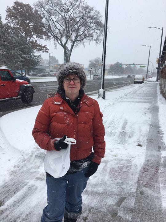 Mary Schmitt of Ferndale says Monday was the first snowy Veterans' Day she can remember/