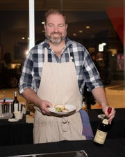 Chef Tom Lents of the Apparatus Room at the Foundation Hotel served food at the event.