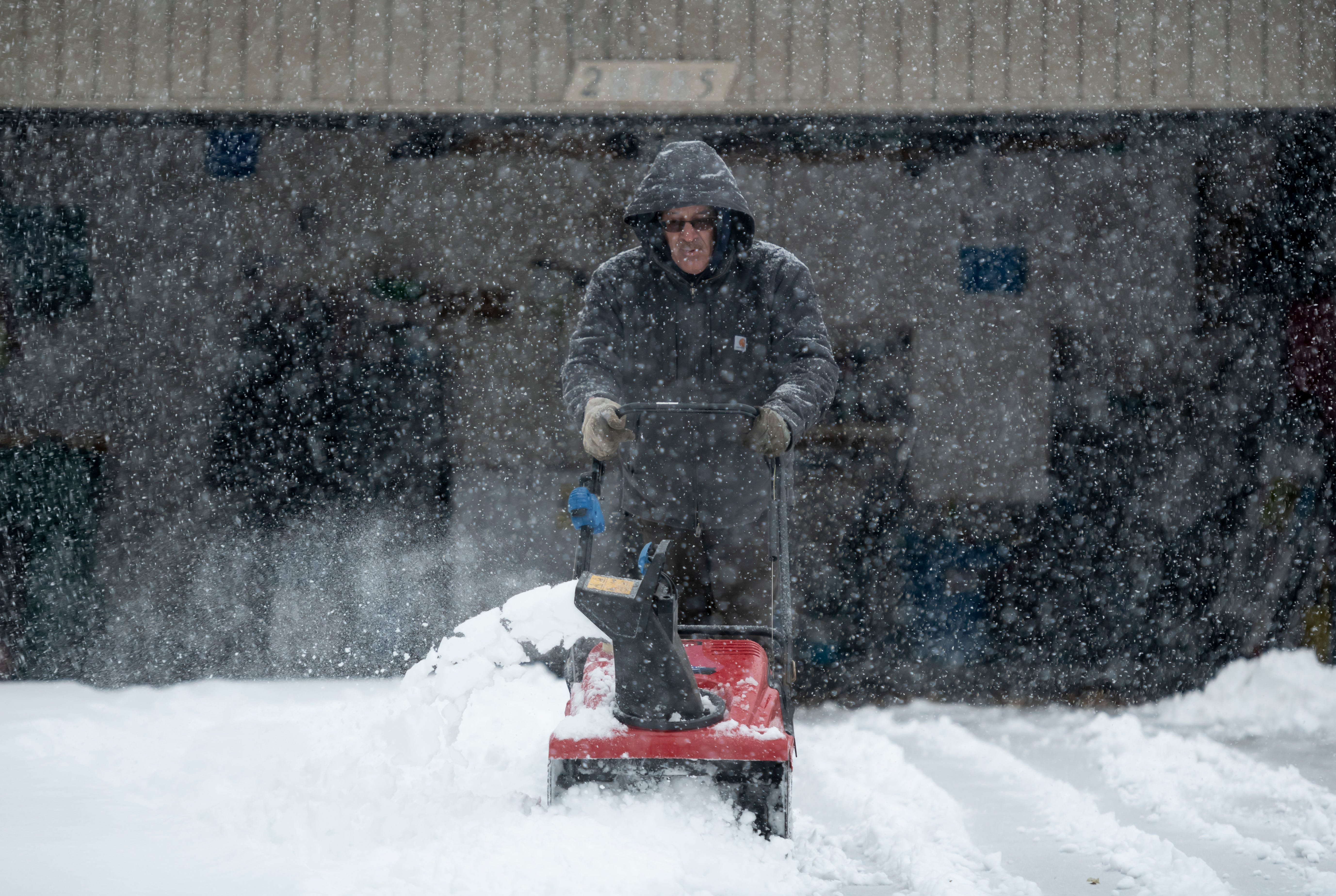 Record-setting snow prompts school closings; record-setting cold likely