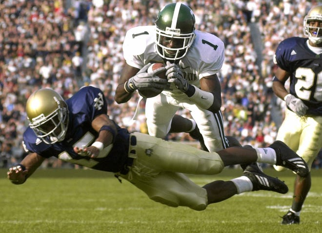 Charles Rogers dives into the end zone during Michigan State's win over Notre Dame in 2001.