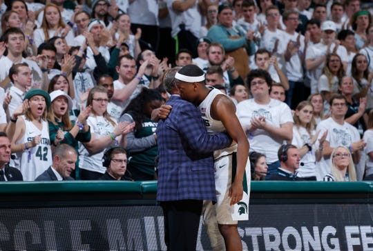 Michigan State's Cassius Winston and coach Tom Izzo embrace as Winston leaves Sunday's game.