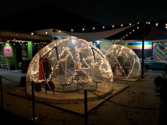 Detroit Fleat in Ferndale is making the most of their patio seating by putting igloos over their picnic tables.