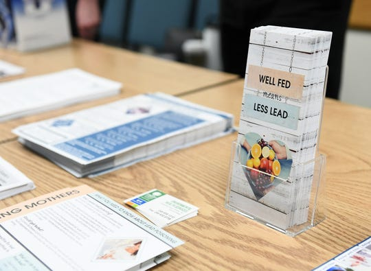 Information about lead is distributed at the Leo Mahany/Harold Meininger Senior Community Center in Royal Oak on Oct. 30.