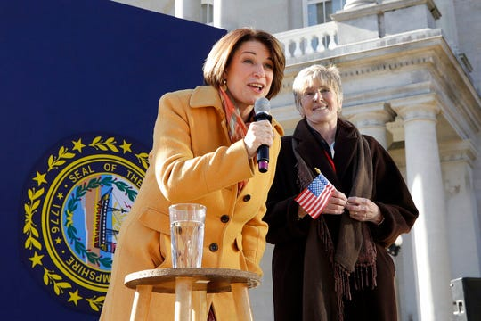 Democratic presidential candidate Sen. Amy Klobuchar, D-Minn., speaks to supporters outside the Statehouse after she filed to be listed on the New Hampshire primary ballot, Wednesday, Nov. 6, 2019, in Concord, N.H. At right is N.H. Executive Councillor Debora Pignatelli.