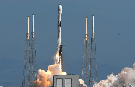 A SpaceX Falcon 9 rocket lifts off from Cape Canaveral Air Force Station, Monday, Nov. 11, 2019, in Cape Canaveral, Fla. SpaceX launched 60 mini satellites Monday, the second batch of an orbiting network meant to provide global internet coverage. (Craig Bailey/Florida Today via AP)