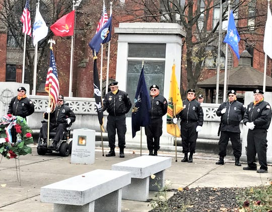 The Vietnam Veterans of America Color Guard, Chapter 803, posts the colors during Monday's Veterans Day observance at Wisner Park in Elmira.