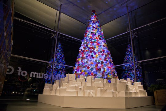 The Corning Museum of Glass celebrates the holidays with handmade ornaments on a 14-foot Christmas tree.