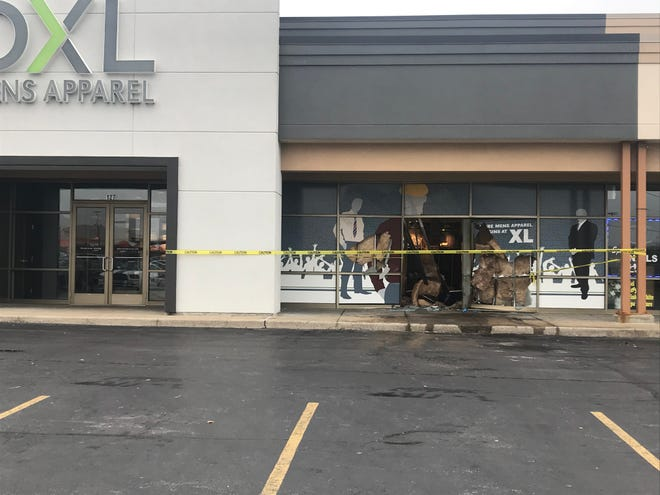 A Cadillac ran into the front of DXL Big + Tall on Evansville's East Side Monday morning.