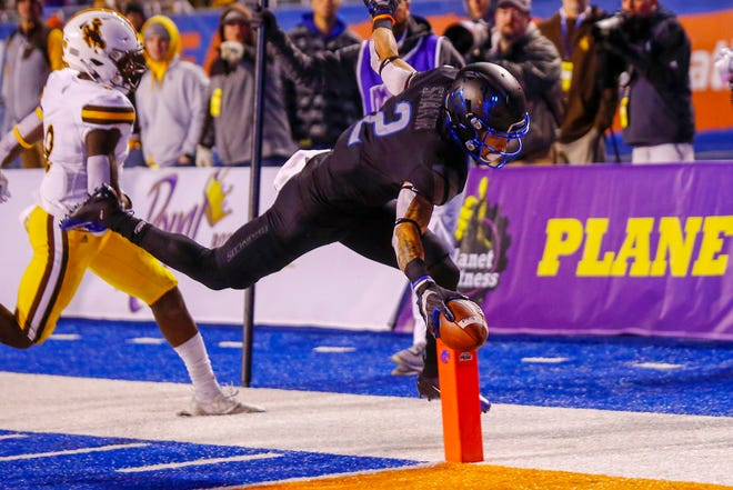 Boise State's Khalil Shakir reaches the football inside the pylon to score a touchdown late Saturday night in the Broncos' 20-17 win over Wyoming at Albertsons Stadium in Boise, Idaho.