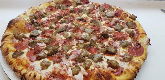 Parkway's Carnivore Lover pizza is among its best sellers. The pie features pepperoni, sausage, ham, bacon and meatballs.