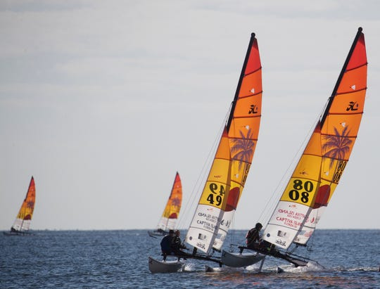 Participants take part in a heat of the Hobie 16 World Championships off of Captiva Island on Monday Nov. 11. 2019. Racers are competing over a two week period. They are bolstering the economy of Southwest Florida by staying at hotels, eating at restaurants and bringing family members.