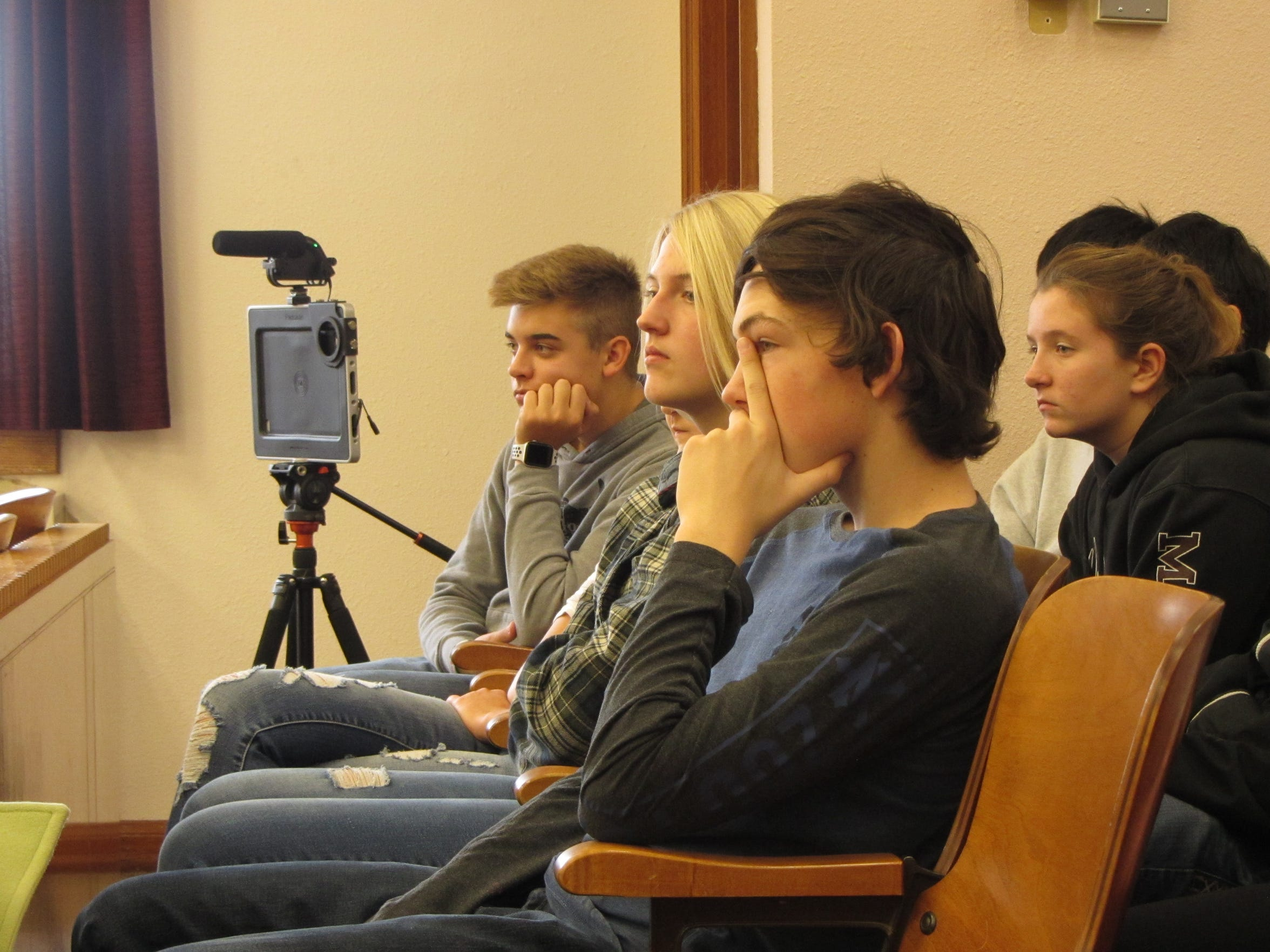 Audience members watch as classmate Mark Doty is tried for vehicular homicide while under the influence as part of Conrad's Ghost Out event.