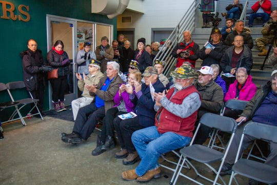 Dozens of community members attended the 14th annual Veterans Day Ceremony that was held in the lobby of Centene Stadium due to inclement weather.