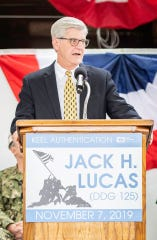 Gov. Phil Bryant speaks at a keel authentication ceremony Thursday, Nov. 7, 2019, at Ingalls Shipbuilding in Pascagoula, Miss., for the DDG 125 named for the late Jack Lucas, a longtime Hattiesburg resident.