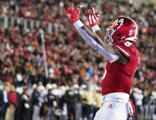 Hoosiers running back Stevie Scott III (8) celebrates after scoring a touchdown during the game against Northwestern at Memorial Stadium in Bloomington, Ind., on Saturday, Nov. 2, 2019.