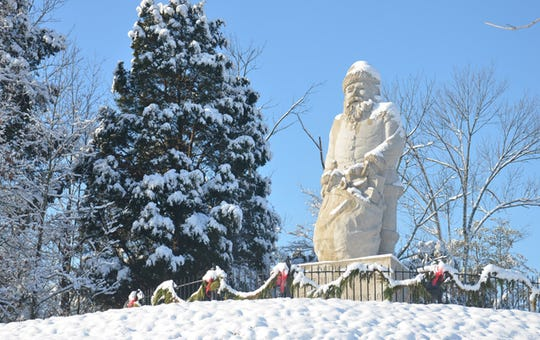 The 22-foot tall Santa Claus statue on top of a hill at the Santa Claus Museum & Village in Santa Claus, Ind.