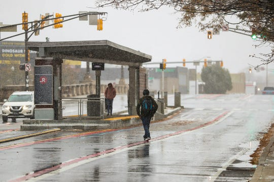 Passengers wait to board the IndyGo Red Line near Fall Creek Parkway Drive, during afternoon snowfall on Monday, Nov. 11, 2019.