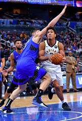 Nov 10, 2019; Orlando, FL, USA; Indiana Pacers guard Malcolm Brogdon (7) drives against Orlando Magic center Nikola Vucevic (9) during the first half at Amway Center.