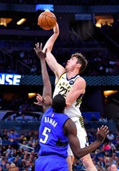 Nov 10, 2019; Orlando, FL, USA; Indiana Pacers forward T.J. Leaf (22) shoots over Orlando Magic center Mo Bamba (5) during the first half at Amway Center.