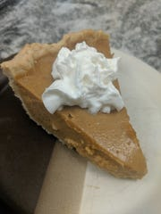 The addition of orange zest and a splash of rum gives this pumpkin pie a little blast of flavor.