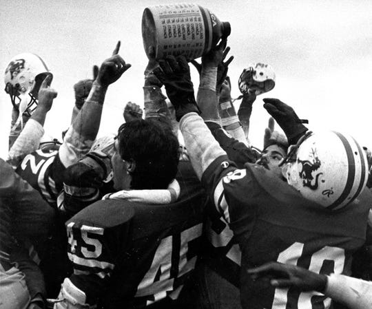 Cortland celebrates winning the Cortaca Jug in 1982. Cortland won, 21-17.