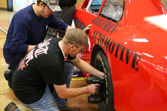 Participants compete in the Pit Crew Challenge at Top Wrench.