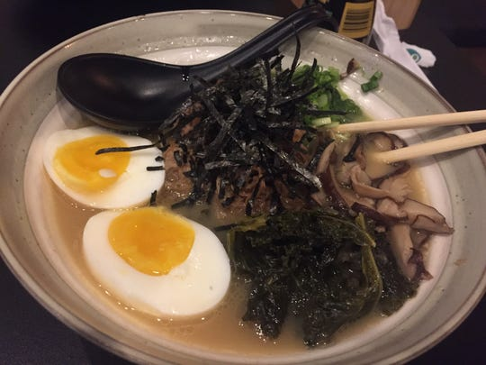 The tonkotsu at Fin-Two Japanese Ale features pork broth, pork belly, kale, shitake mushrooms, burnt garlic oil, negi, nori and soft-boiled egg.