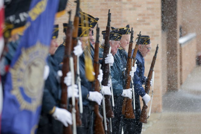 Members of the American Legion Post 492 stand at attention while a volley is fired during the playing of taps at a Veterans Day Ceremony at Indiana Veterans' Home, Monday, Nov. 11, 2019 in West Lafayette.