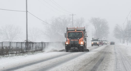 A truck clears snow on Jolly Road near College Monday, Nov. 11, 2019.