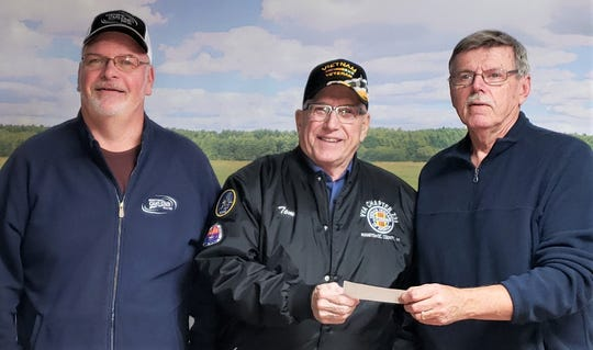 At the November meeting of the Manitowoc Gun Club, President Brian Schulz and Treasurer Gary Hansen presented a check for $781 to Manitowoc County United Veterans Council Chairman Tom Hoffman.