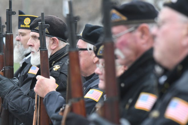 Members of the Richland County Joint Veterans Burial Squad listens to Taps after firing three volleys during the Veterans Day Ceremony.