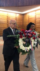 Employees at Memorial Park Cemetery carry out the laying of the wreath during a small Veteran's Day ceremony.