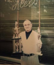 The late Alex Kasaftes in front of Alex's Tavern.