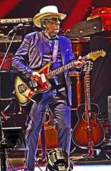 """Elvis Costello performs during opening night of the """"Just Trust"""" tour on Oct. 23, 2019, in Charlottesville, Va."""