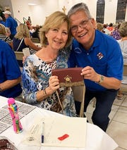 On Thursday, Oct. 31, the Knights of Columbus San Marco Council #6344 hosted a special Bingo night with a Halloween theme in the San Marco Parish Center.  Above: Coach bag winner, Kristin Schiller of Marco Island.