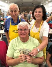 JCMI Bingo winner John Pushic of Greensburg, Pennsylvania, with Herb and Hanita Kern.
