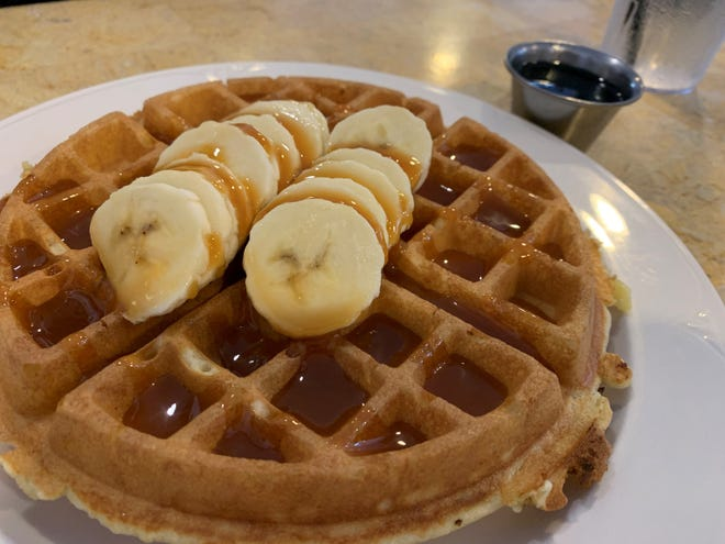Belgian waffle with bananas and caramel sauce from Petit Soleil, Marco Island.