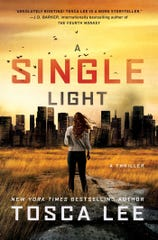 """A Single Light"" by Tosca Lee."