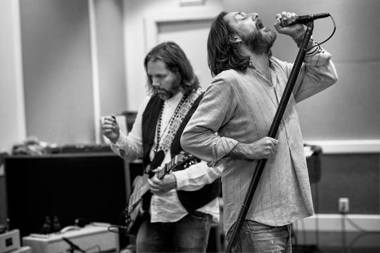 The Black Crowes, featuring once-estranged brothers Rich Robinson, left, and Chris Robinson, have reunited to tour for the first time since 2013.