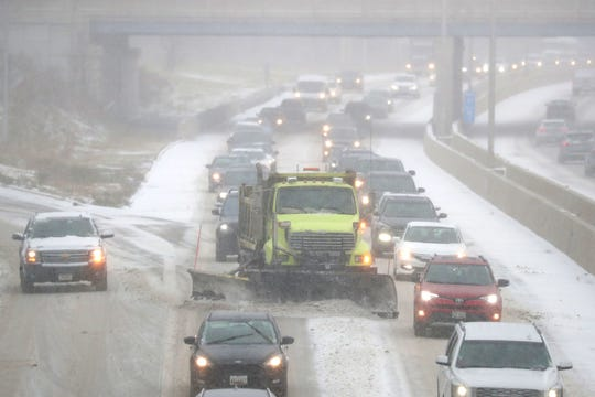 A Milwaukee County snow plow makes its way through traffic as it clears the snow from I-43 just north of West Green Tree Road in Glendale on Monday. Snow began falling overnight and is expected to continue throughmuch of Monday morning, bringing 3 to 4 inches of snow to metro Milwaukee and 4 to 6 inches in Racine and Kenosha counties.
