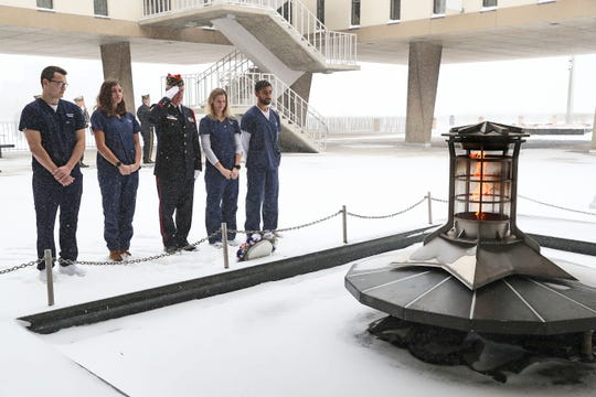 Senior nursing students from Marquette University School of Nursing who are taking part in the Veterans Affairs Nursing Academic Partnership lay a wreath at the flame on the deck of the War Memorial Center.  The nurses in the program are training at the Milwaukee VA Medical Center and will work for the VA for at least two years upon graduation. A program was held at the War Memorial Center in Milwaukee in honor of veterans on Veterans Day 2019.  The program was conducted by members of Milwaukee Police Post 415 and Milwaukee Firefighters Post 426 of the American Legion.