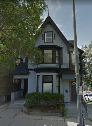 A downtown duplex can be deconstructed for new apartments after a historic designation request was denied.