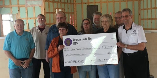 The Mountain Home Elks Lodge recently donated $5,000 from funds raised at their annual Elks Veterans Golf Tournament to the Bob Davis Veterans Center. Pictured are: (first row, from left)Joanna Baxter Farris, Veterans Center treasurer; Shari Kane, Veterans Center secretary; Patty Underwood; Clint Gunderson, Elks Veterans committee members;(second row)Al Underwood;Ben Woody, Elks Veterans committee members; Bill Patrick, Veterans Center board member;James Johnson, Veterans Center board member; and Roger Smith, Veterans Center president.