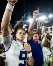 LSU quarterback Joe Burrow (9) and LSU head coach Ed Orgeron after defeating Alabama at Bryant-Denny Stadium in Tuscaloosa, Ala., on Saturday November 9, 2019.
