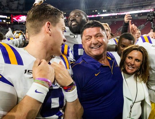 LSU quarterback Joe Burrow (9) talks with LSU head coach Ed Orgeron after defeating Alabama at Bryant-Denny Stadium in Tuscaloosa, Ala., on Saturday November 9, 2019.