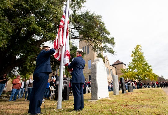The Prattville High School Air Force JROTC raise the American flag during the Veterans Day Observance in Prattville, Ala., on Monday November 11, 2019.